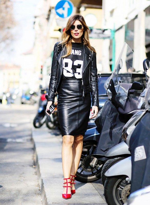 Black leather moto jacket paired with a leather pencil skirt and black tee with a pop of red