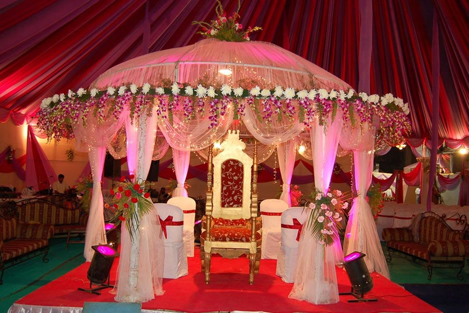 Indian weddings grand pink mandap indian wedding for Wedding hall decoration photos