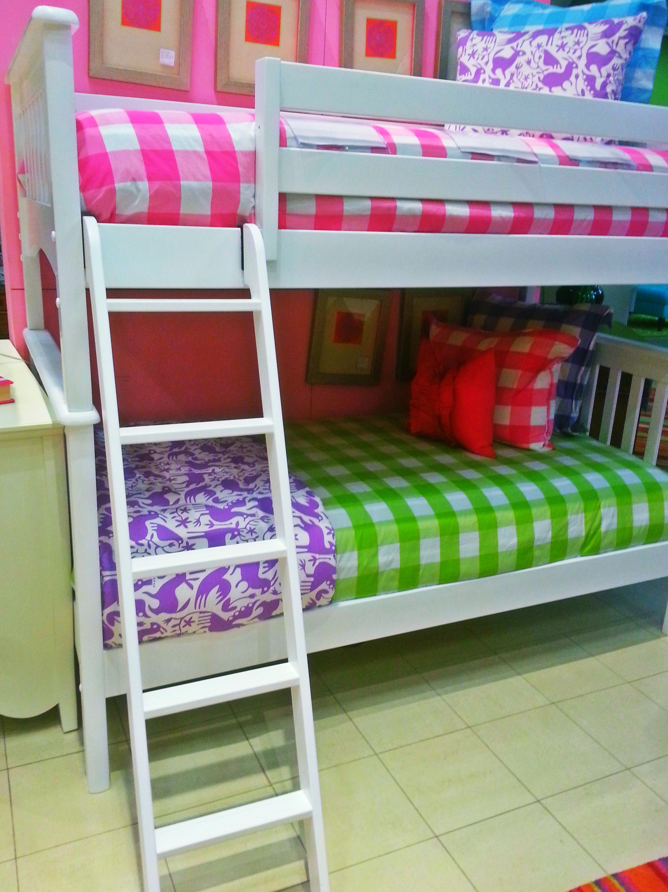 Have fun dressing your daughter s bunk bed set by mixing bright