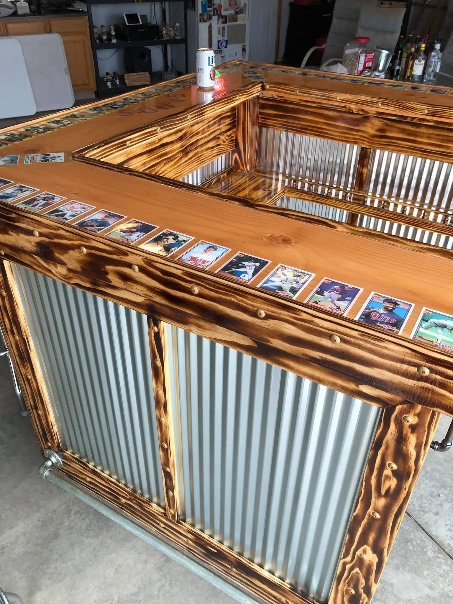 Bar i built for friends 50th sports cards under epoxy top