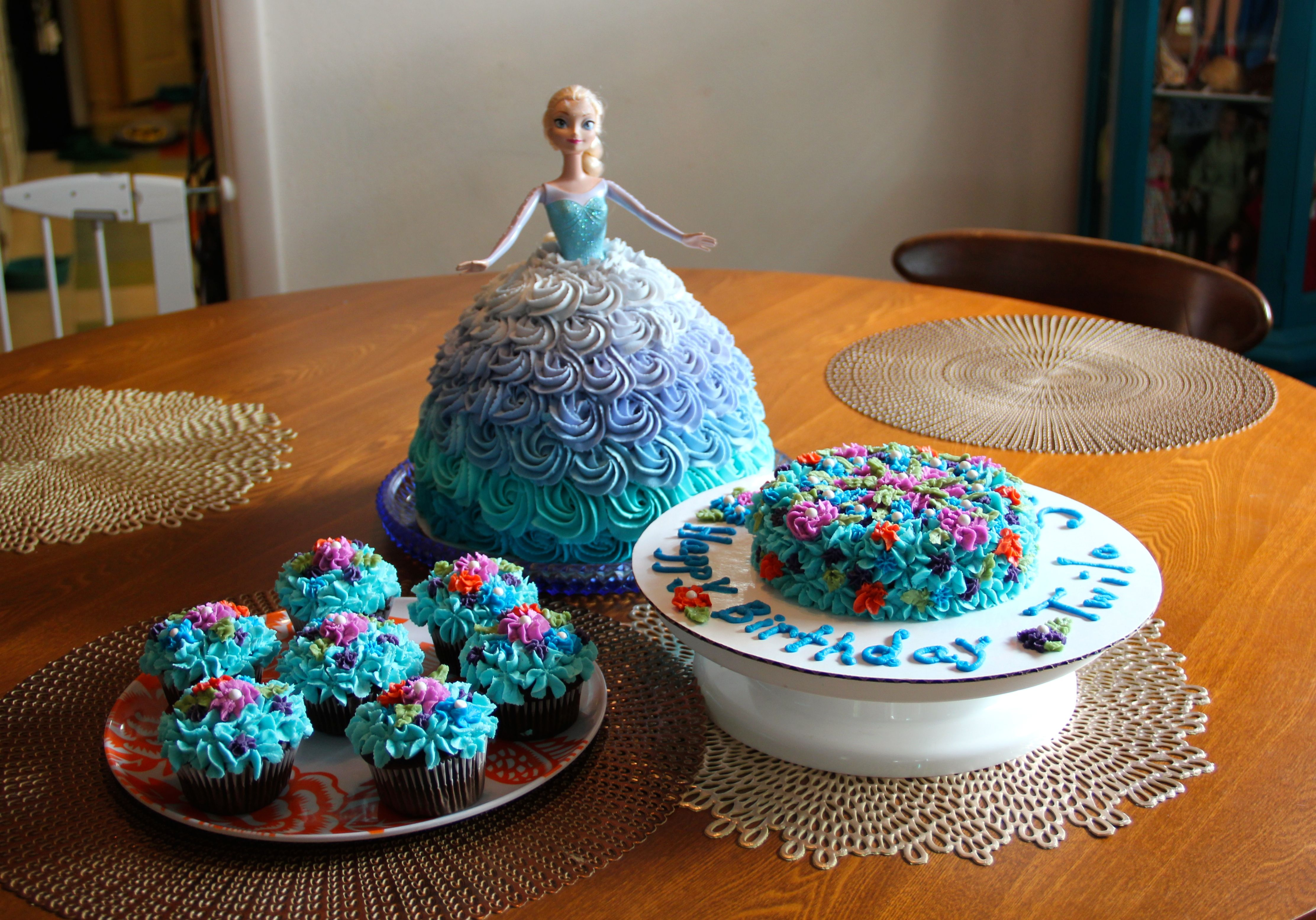 Frozen elsa doll cake  Frozen Birthday party cakes Elsa doll cake floral Anna cupcakes