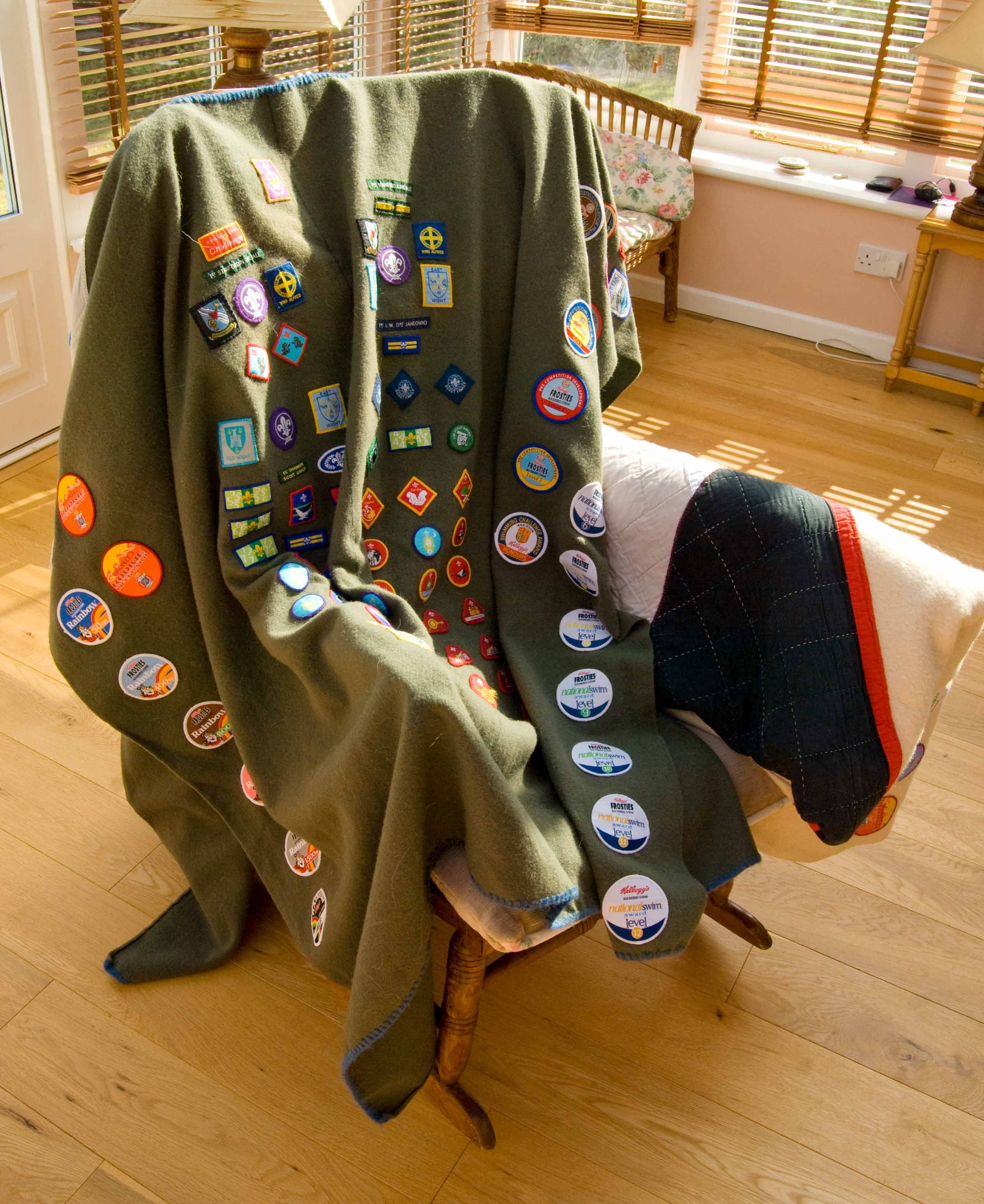 Sew all of Brady's Scout badges to a display blanket  | Sew