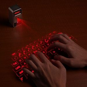 ThinkGeek :: Cube Laser Virtual Keyboard for iPad & iPhone - StyleSays