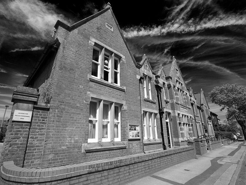 A dramatic black and white image of Farnworth Police Station, which is situated on Greater Manchester Police's Bolton Division. Opened in 1879, it is a fine example of the 'County' style police station of the day. www.gmp.police.uk