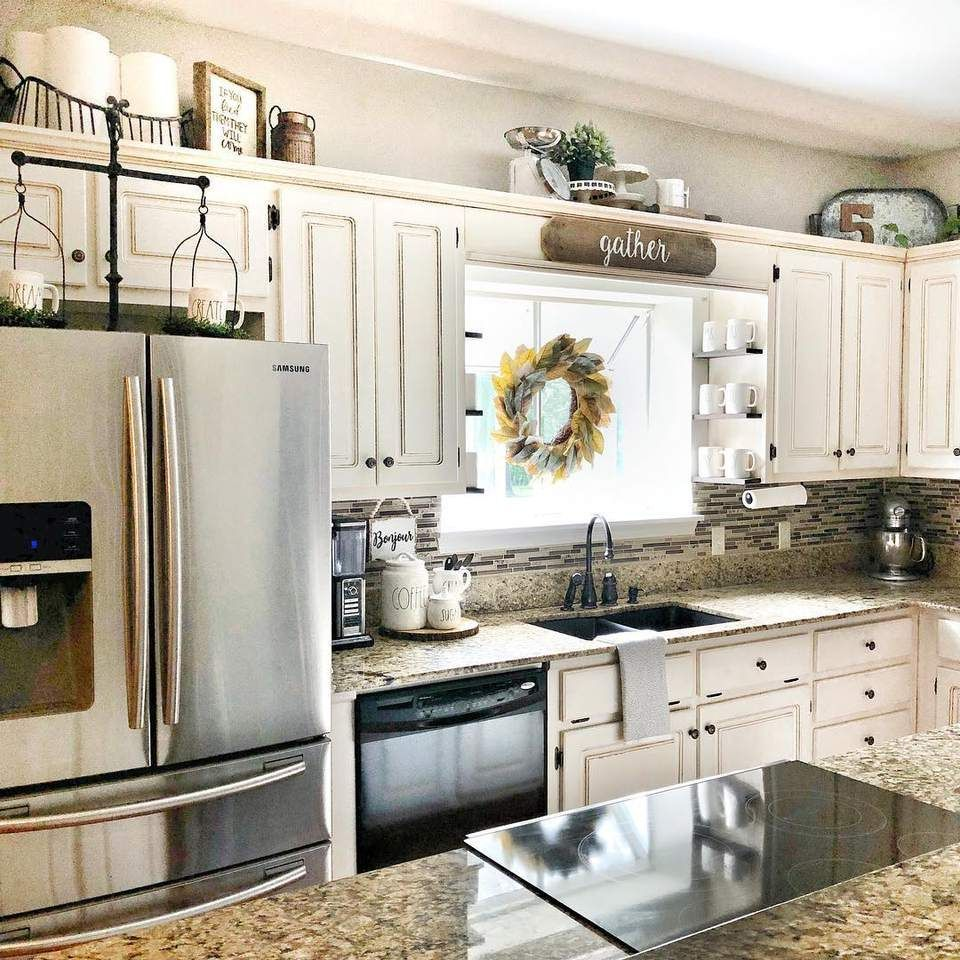 9 New Ideas For Decorating Above Your Kitchen Cabinets In 2020 Kitchen Cabinets Decor Kitchen Decor Apartment Above Kitchen Cabinets