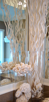 Photo Image Tall glass vase corkscrew willow branches and sea shells