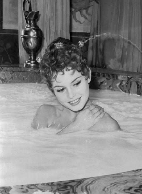 crfashionbook Brigitte Bardot bathing in milk in