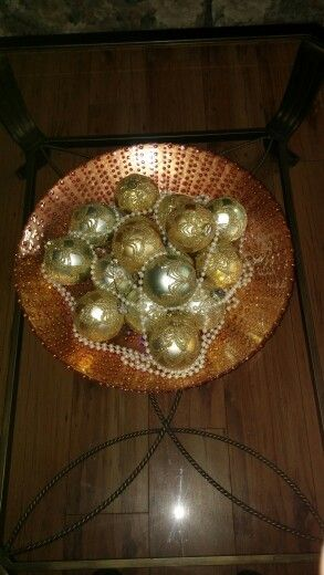 A beautiful and easy table centerpiece! A large decorative bowl, any size bulbs and a strand of pearls!