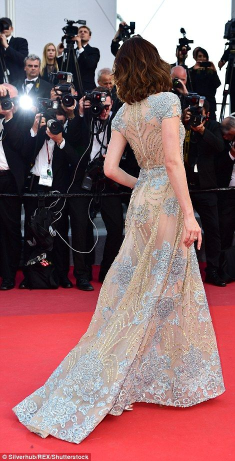 Poser: The star made full use of the pockets on her gown and shook her tousled chestnut lo...