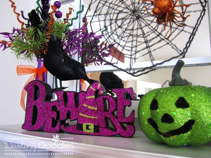 dollat store glitter pumpkins | glittery scrapbook paper cut into stripes  makes a cute display. Glitter PumpkinsHalloween DecorationsHalloween ...