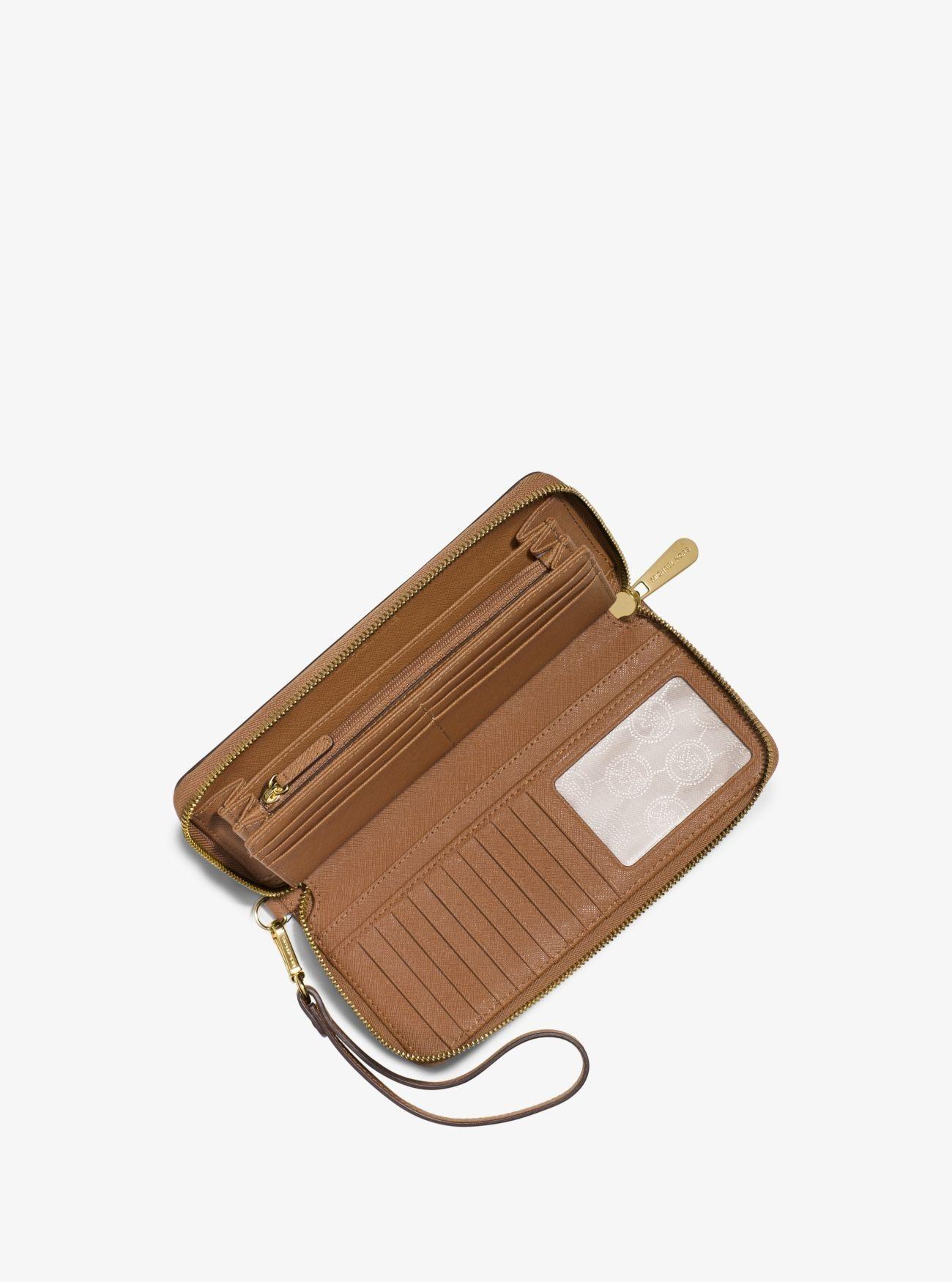 fc1a80baeff9 Online Michael Kors Acorn1 Jet Set Travel Leather Continental Wristlet Cheap