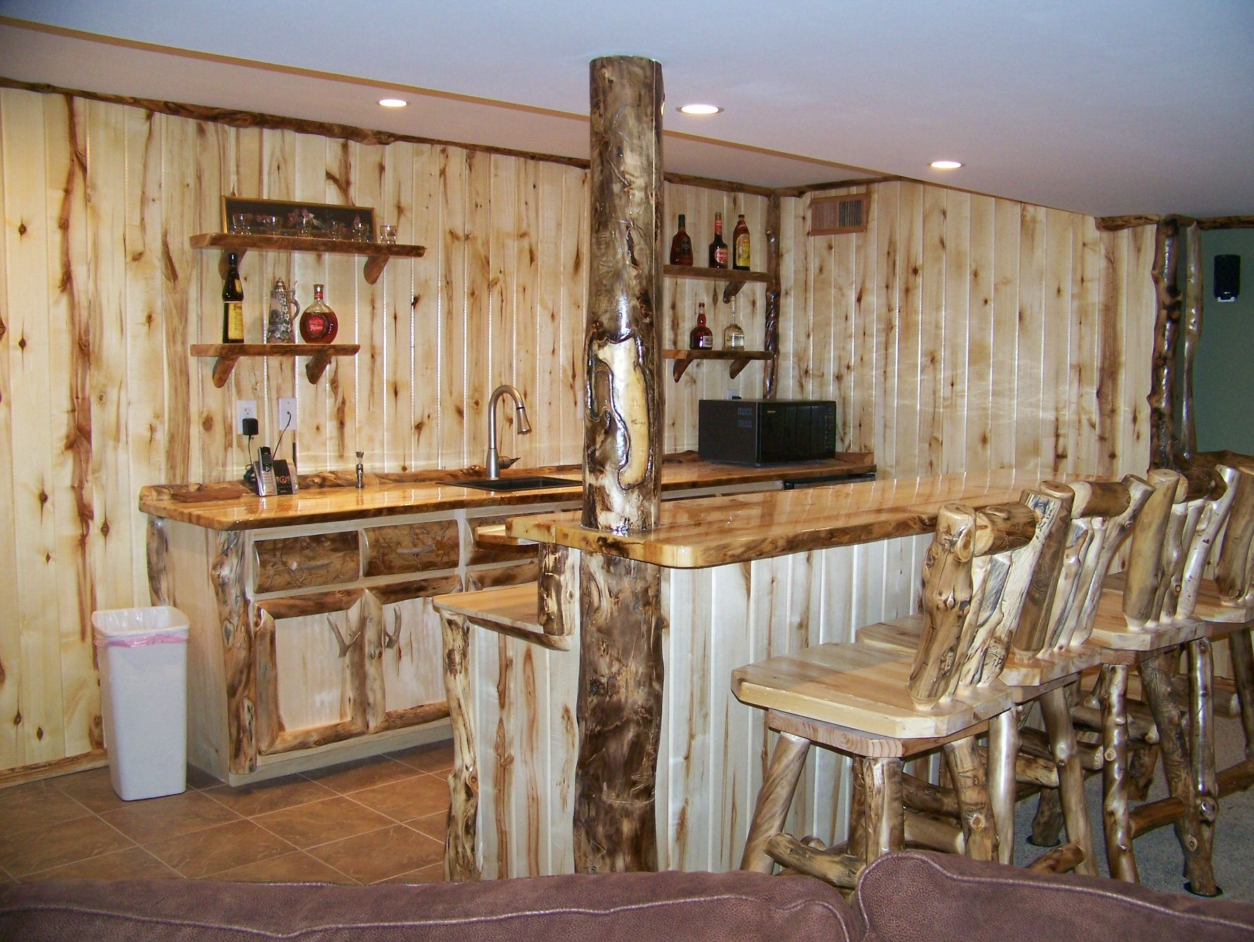 This is my boyfriend's work... he is so talented! Rustic style mancave complete with log bar and chairs from Touch of the West