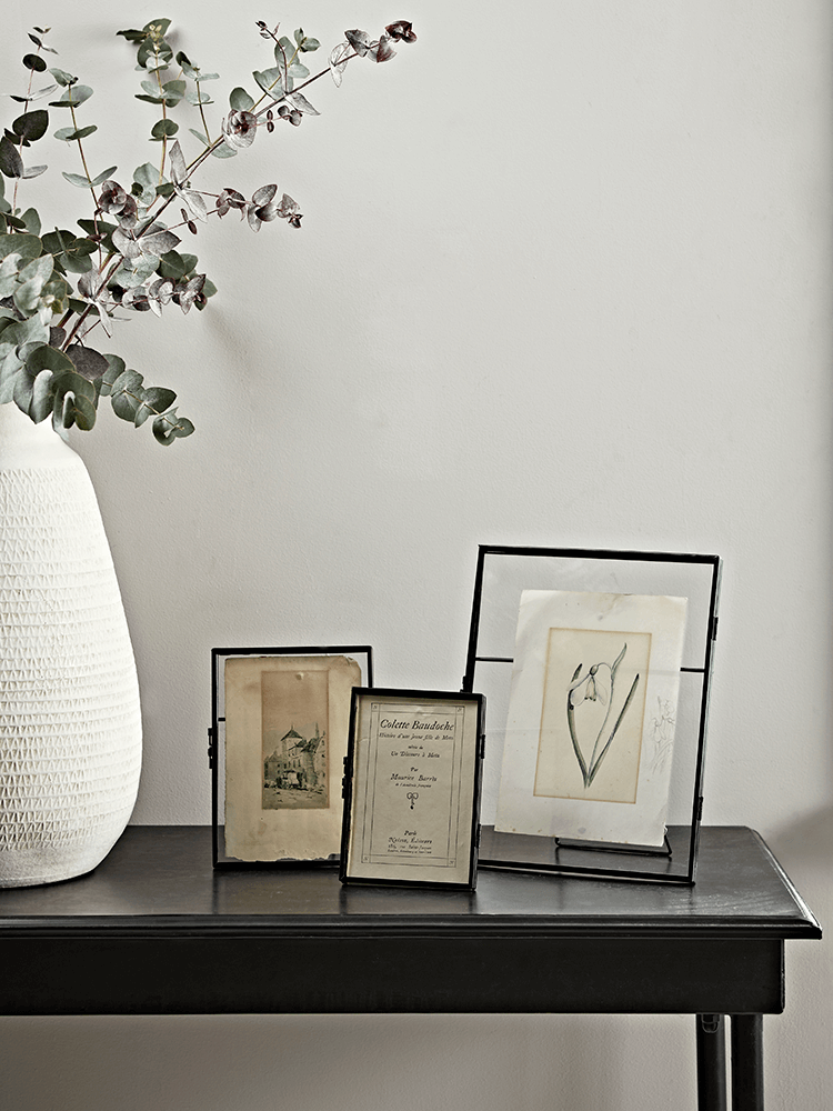 "Made from glass with a fine black metal rim, these delicate hinged frames are perfect for displaying your favourite photographs, flowers or keepsakes and adds instant charm to any windowsill or mantelpiece. With space to hold photos measuring up to 4"" x 6"" (Small), 5 affiliate link"