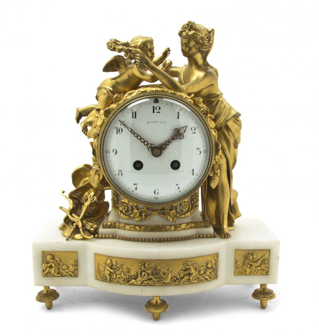 A French Gilt Bronze and Marble Figural Mantel Clock, retailed by Tiffany & Co.,
