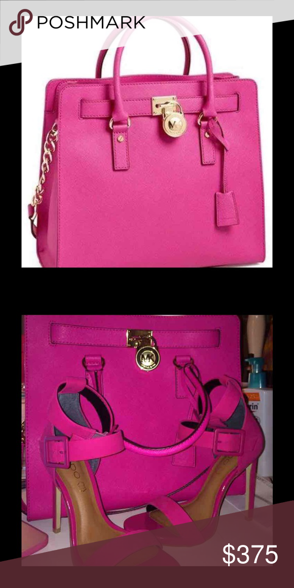 Michael Kor pink large SAFFIANO Hamilton bag Like new worn a few times but  no flaws. It is the MOST GORGEOUS hot pink color 😍 large locket on the  front ... 01cfc9939d