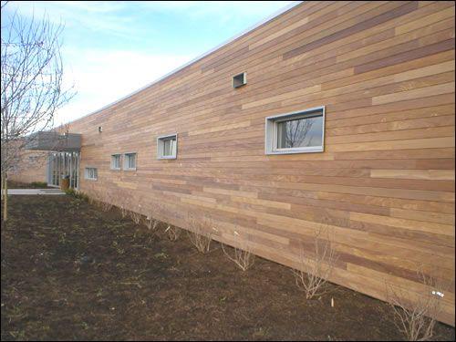 Example Of Flat Horizontal Wood Siding Of A Medium Color House Exterior Wood Siding Lake House