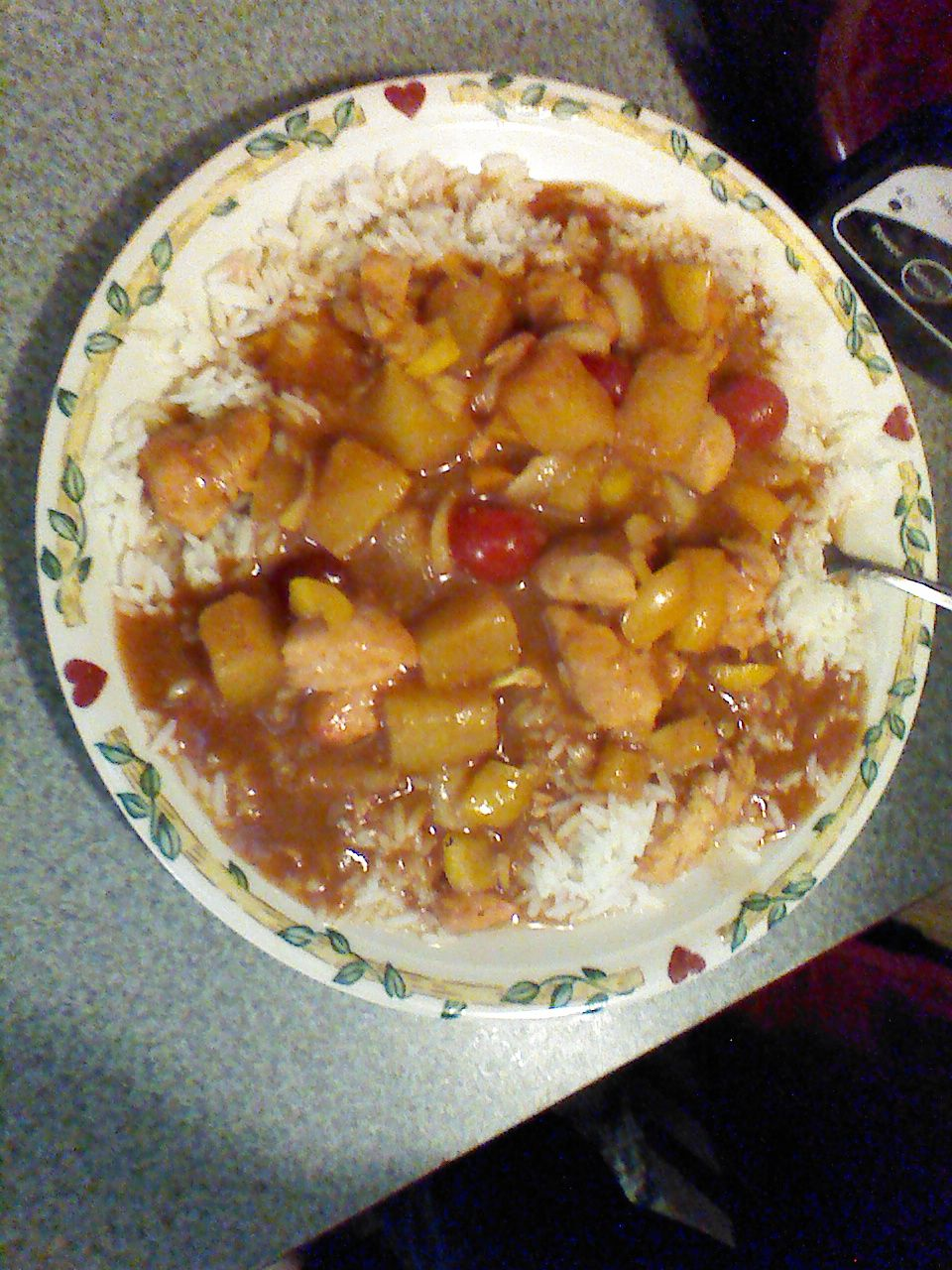 chicken, pineapple, cherries, onions, orange and yellow peppers in honey mango BBQ sauce over white rice, my man is an awesome chef!!!