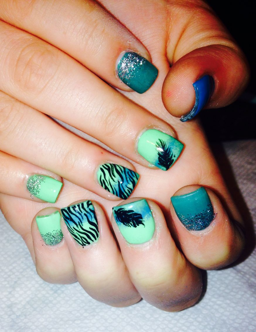 Inspired by online photo! Acrylic nails//feather nail design//blue ...