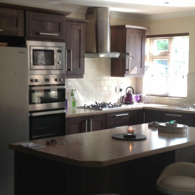 walnut kitchen with white subway tile backsplash b for