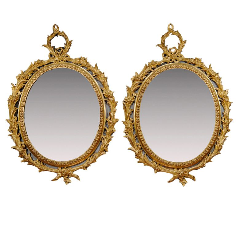 Pair of george iii carton pierre oval gilt mirrors for Miroir french to english