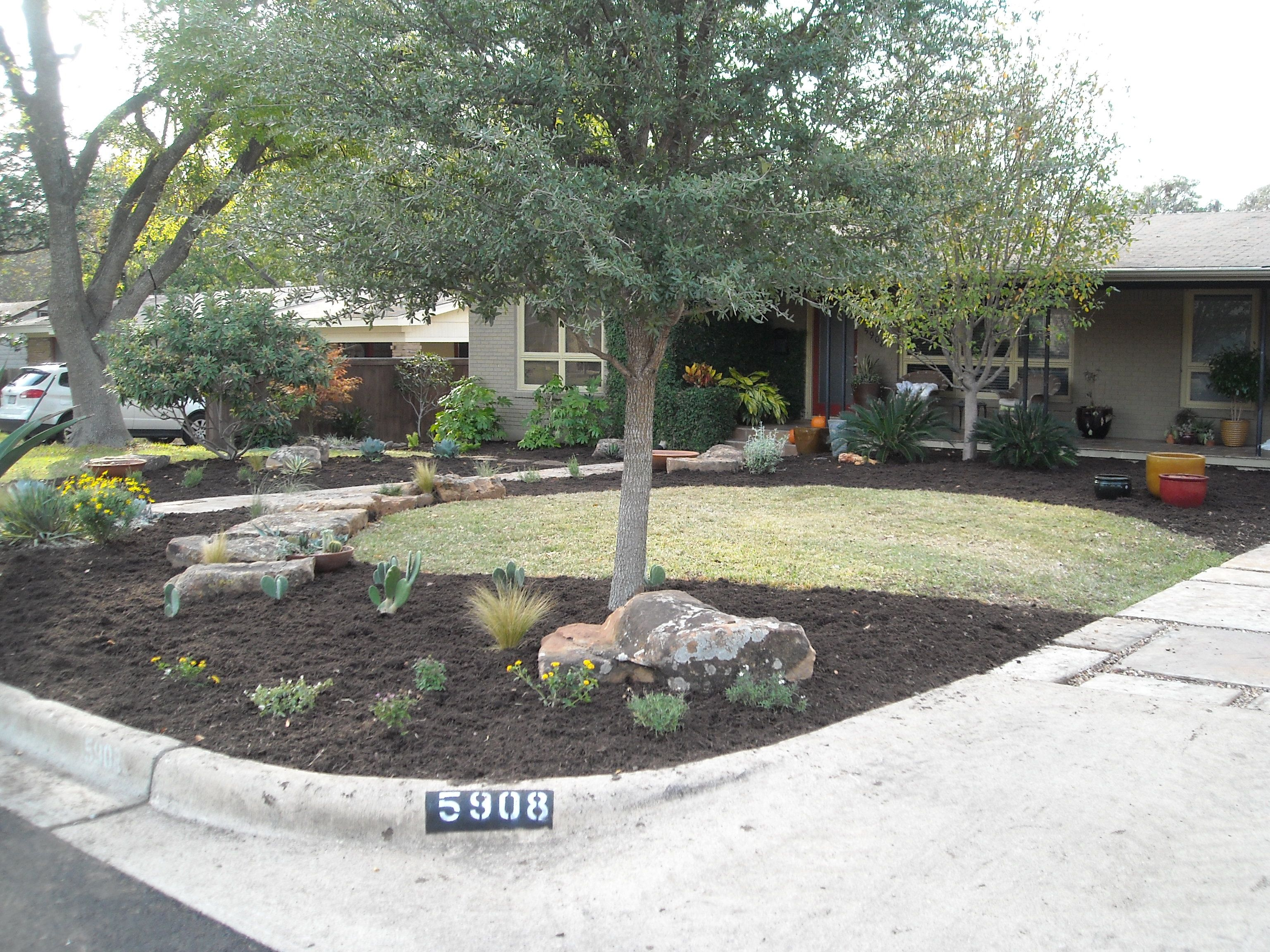 Front yard landscape - large boulders, sweeping mulch beds ...