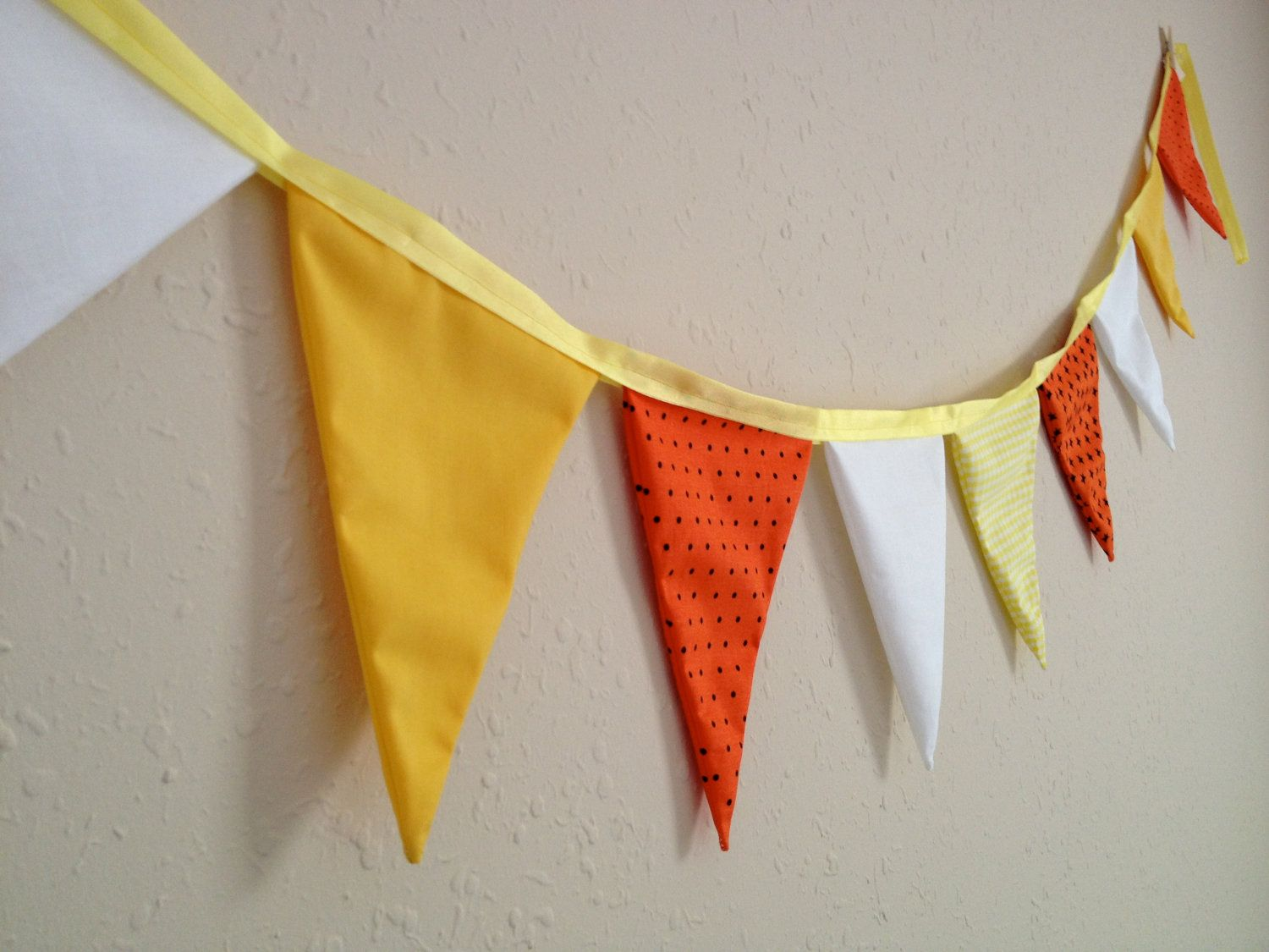 Candy corn fabric banner in yellow orange and white pennants