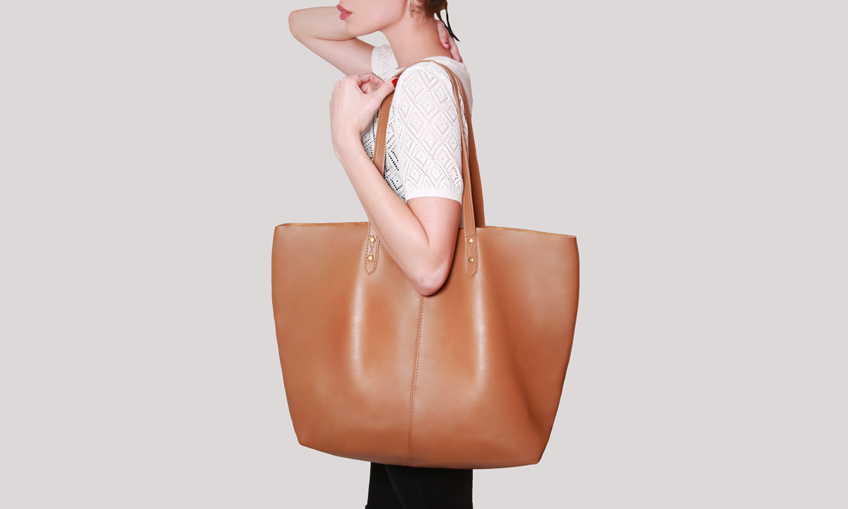 3916f79fcb6 This stunning brown leather tote bag is beautifully unstructured ...
