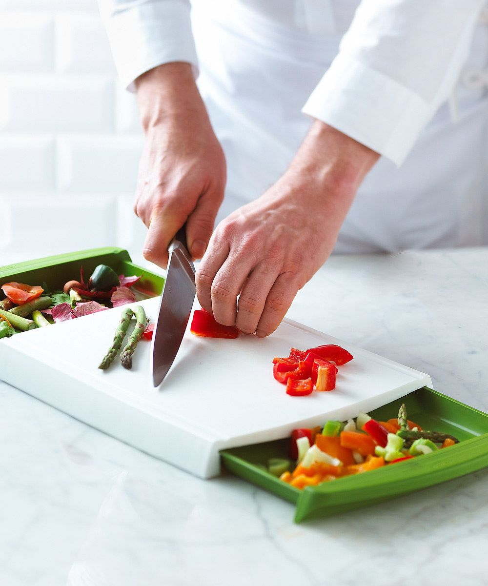 Chopping Board // with 2 drawers, one for already cut veges and one for collecting the scraps... clever! #productdesign