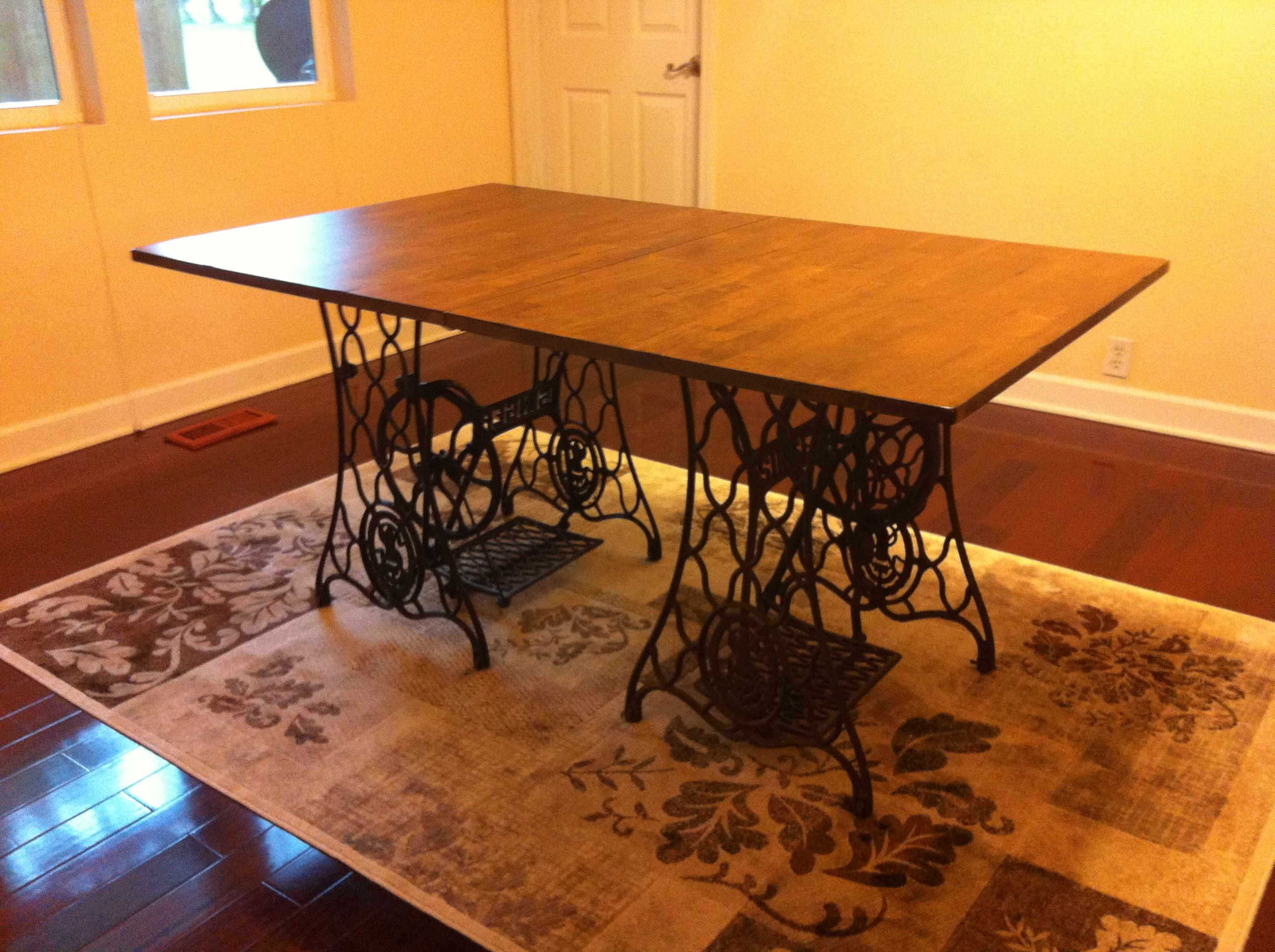Bought The Table Top For $30 At A Furniture Store. My Mom Had One Singer  Sewing Machine Leg And Bought The Other One For $40!! Made A Kitchen Table  For $70 ...
