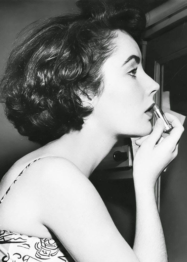 Makeup checkup u2013 Elizabeth Taylor putting on lipstick Photography Vintage Pinterest