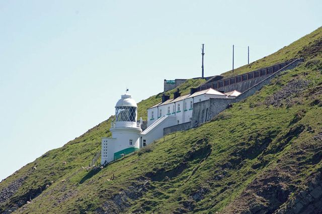 It's National Lighthouse Day!  Lynmouth Foreland lighthouse offers views of sheltering porpoises and seabirds.  #lighthouse #sea #nautical #Devon