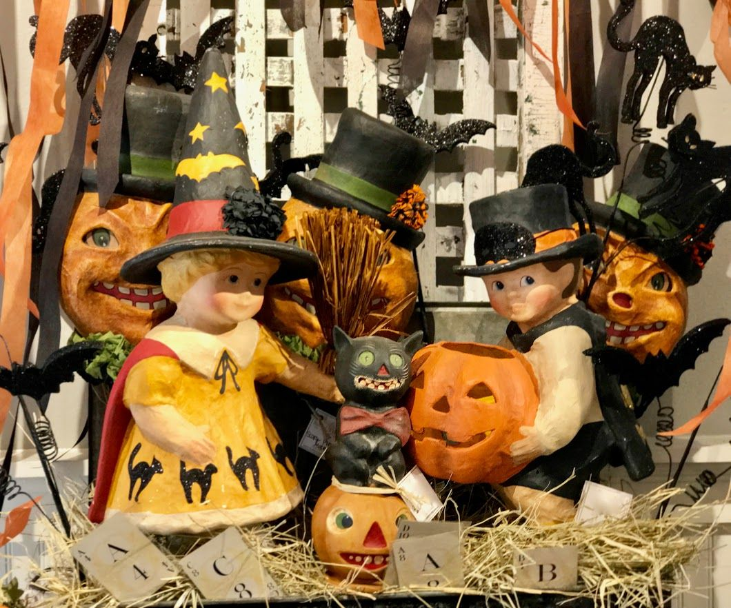 paper mache halloween guy and girl, cats and pumpkins with hats