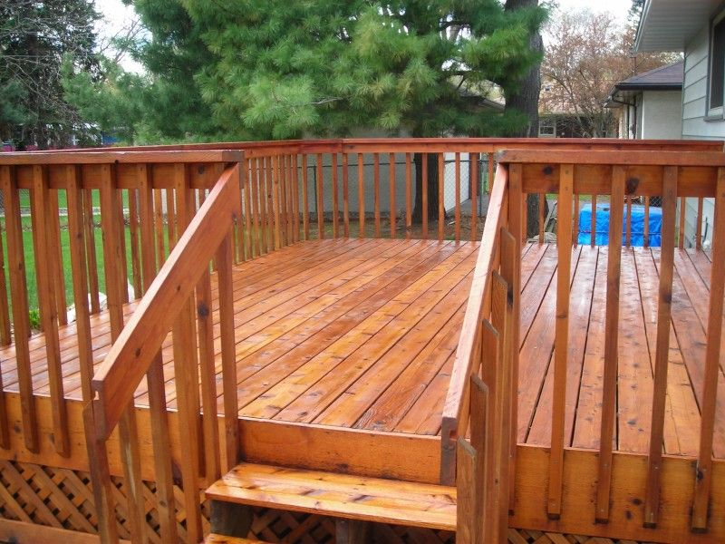 a deck is stained light brown and finished with gloss Wood decks