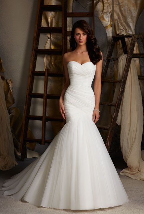 Morie Lee Draping is extra slimming; the spray of tulle on the bottom balances out a big bust.  Net fit-and-flare wedding dress, $649, Mori Lee by Madeline Gard. $$