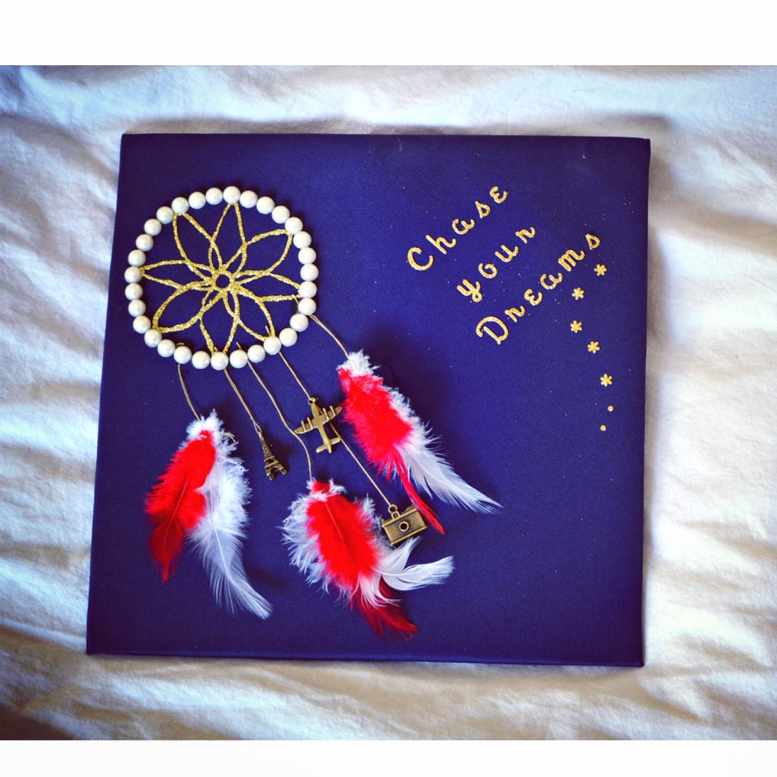 Made my own dreamcatcher graduation cap The charms represent my
