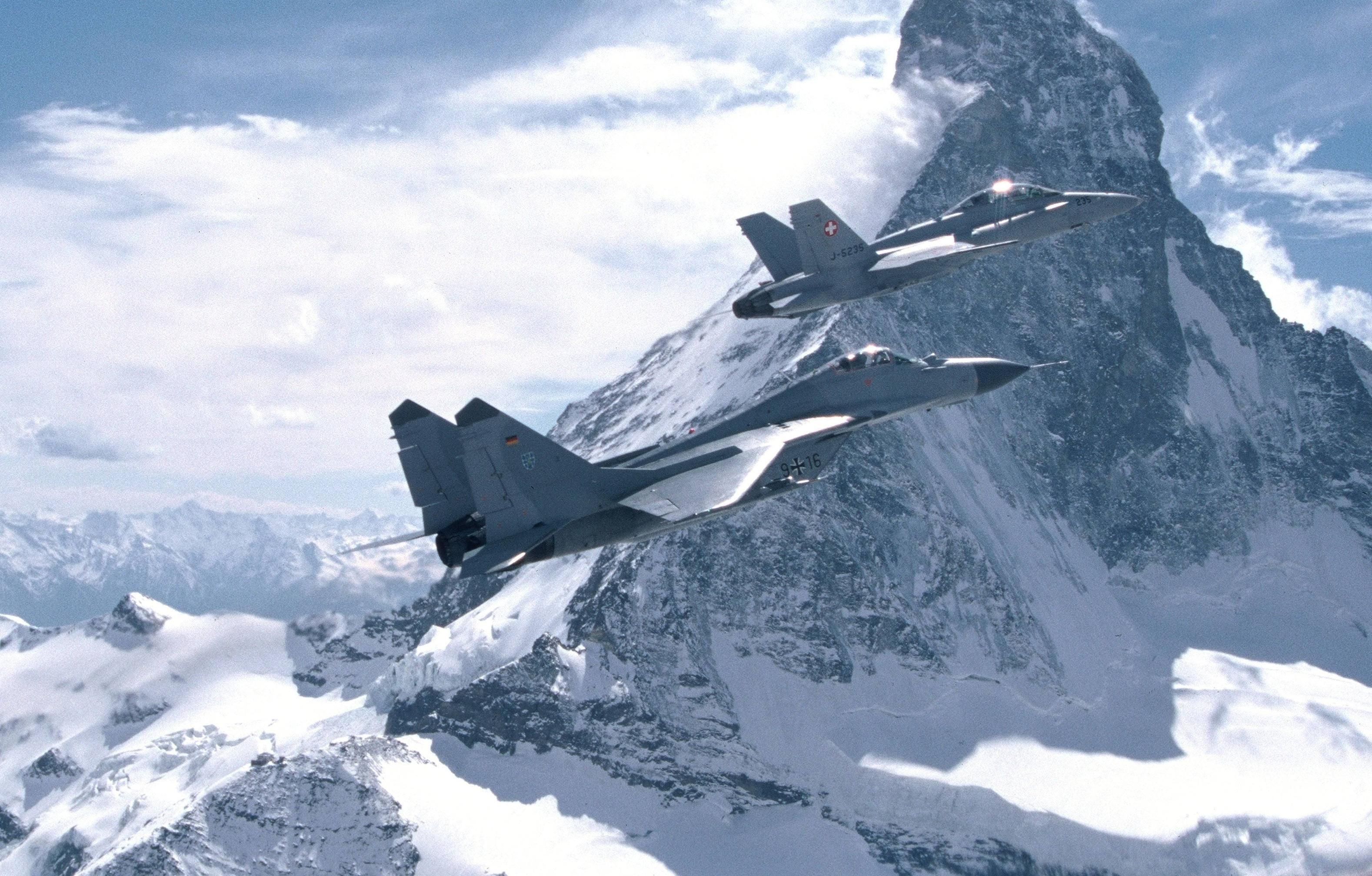 Swiss Air Force F18 and German Luftwaffe MiG29 next to