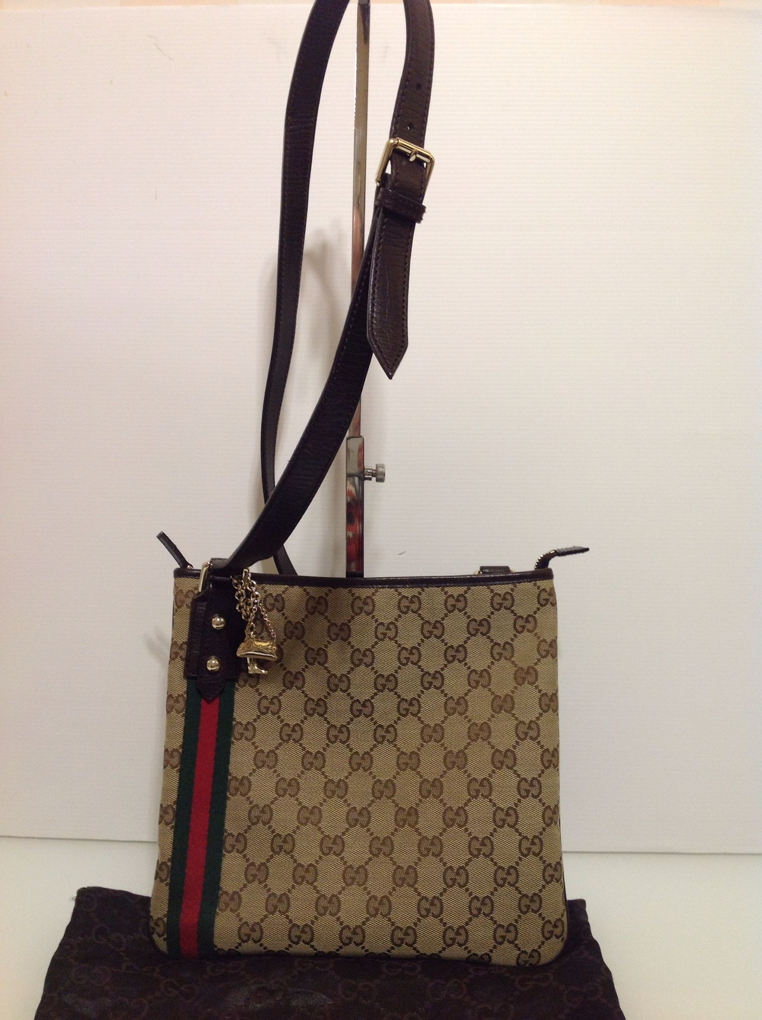 1ace59392afc4f Authentic Gucci Cross Body Bag in GG Mono with Charm and Dust-bag 295 This  is a guaranteed authentic Gucci bag. It can be viewed and tried at our  designer ...