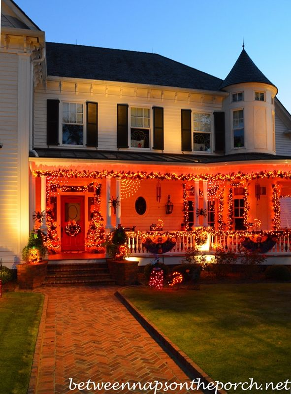 Beautiful Victorian Home Aglow For Halloween Halloween Porch Decorations Halloween Front Porch Outside Halloween Decorations
