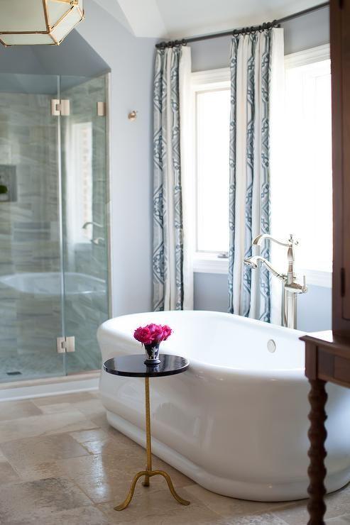 Beautiful Master Bath With A Freestanding Oval Bathtub Filling A Bay