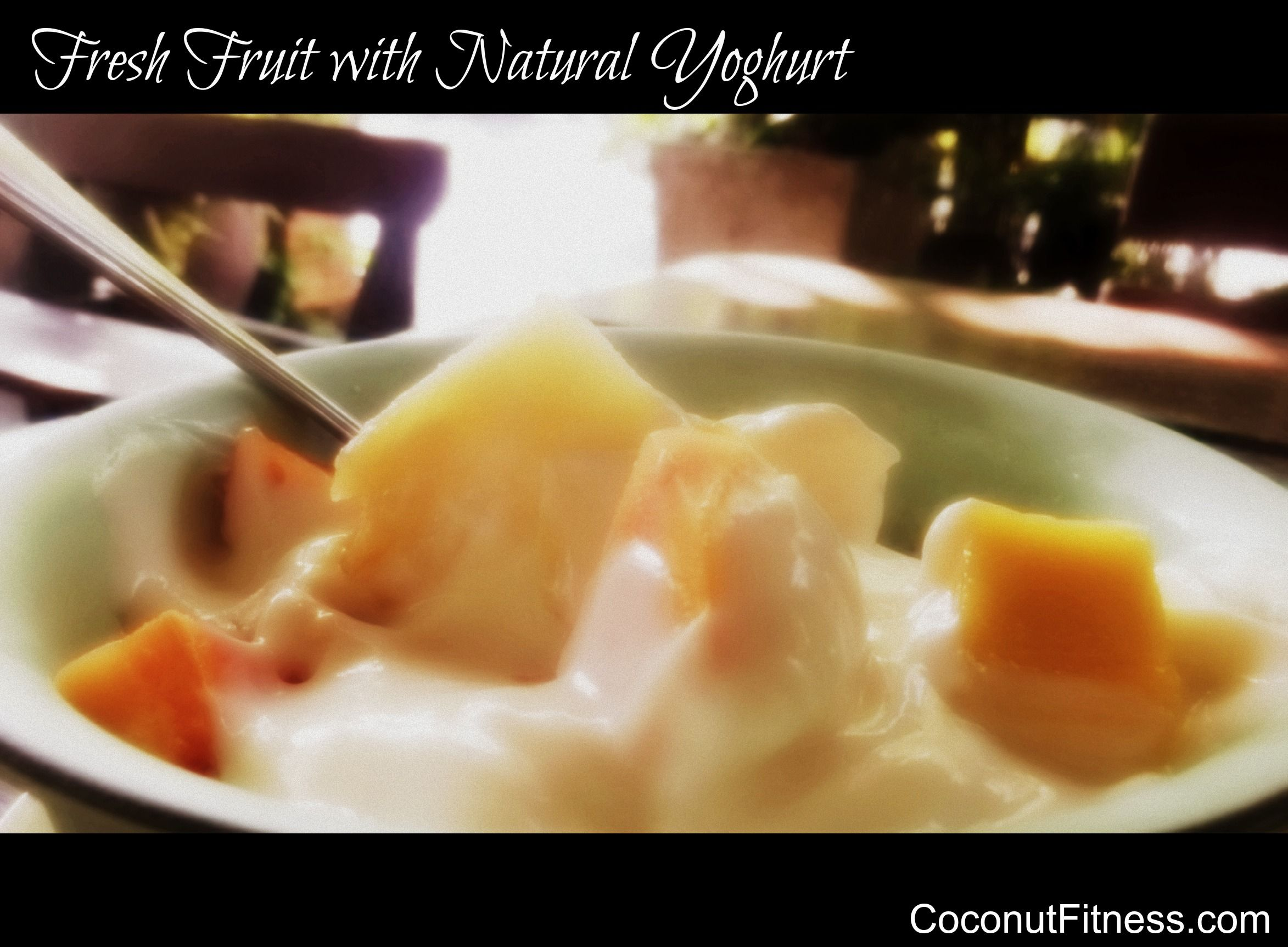 Fresh fruit salad with natural yoghurt, add in nuts and seeds for a good metabolic typing breakfast www.coconutfitness.com