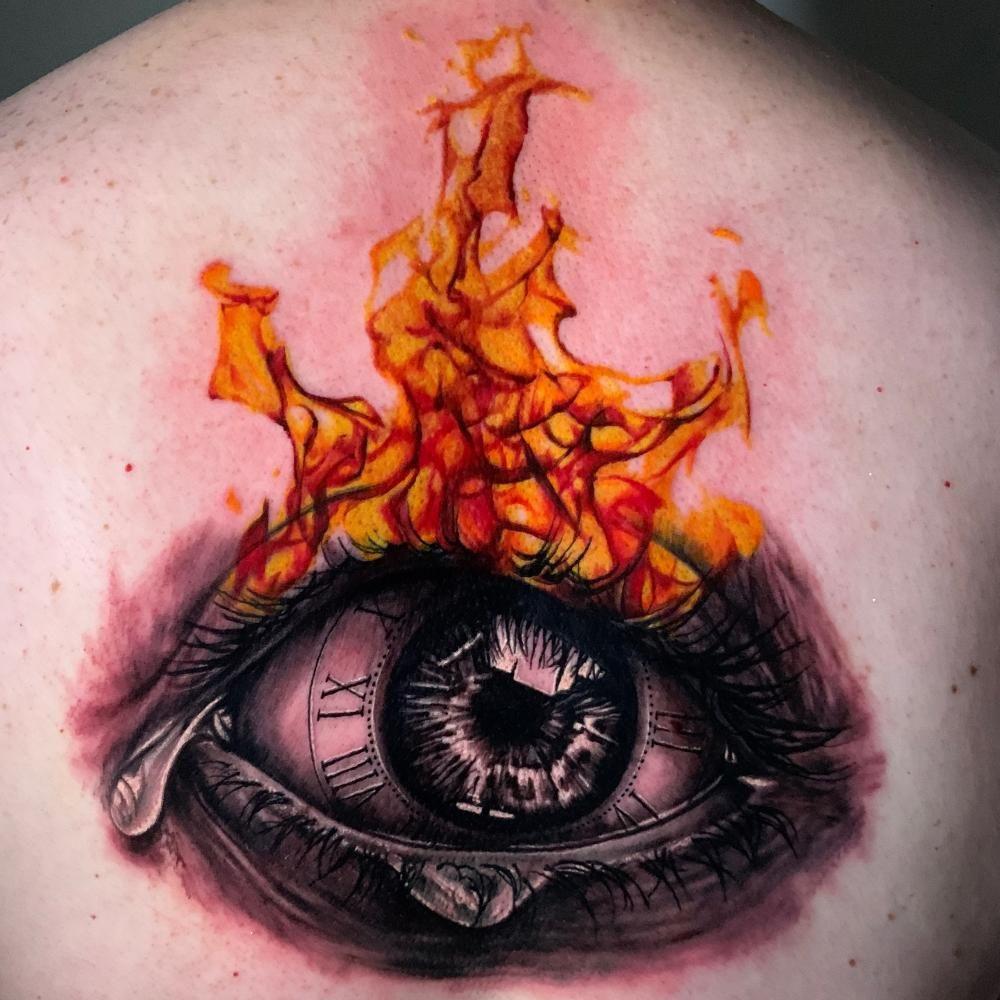 Eye with fire tattoo. #SimpleEyeTattoos #EyeTattoos #EyeTattoosForMen #EyeTattoosOnBack #TattooIdeas #TattooAwards