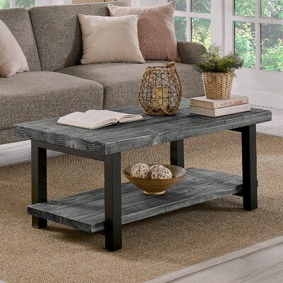 Trent Austin Design® Gorgeous solid wood table offers rustic farmhouse style. In fact this coffee table is versatile enough to work in a variety of design styles. With its solid Pine top with a mix of new and reclaimed wood you will find knots, cracks and other features that make each table unique.  The lower shelf offers additional space for storage and display. Table Top Color: Slate Gray