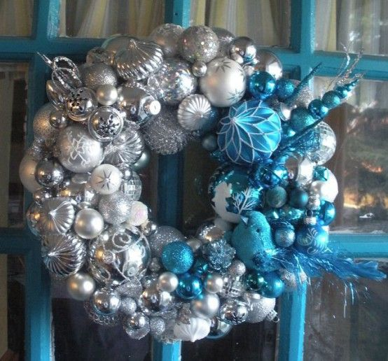 Take blue and silver ornaments and decorate your tree, doors, stairs