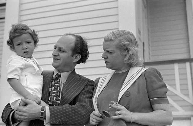 Larry Fine standing with his wife Mable and holding his son Johnny. Steel Pier, Atlantic City, New Jersey, 1938. Photo by George Mann of the comedy dance team, Barto and Mann.