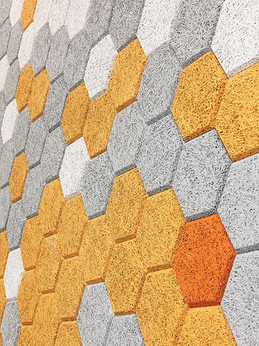 Traullit decor - sound insulating, heat and moisture moderating hexagons of wood and cement.