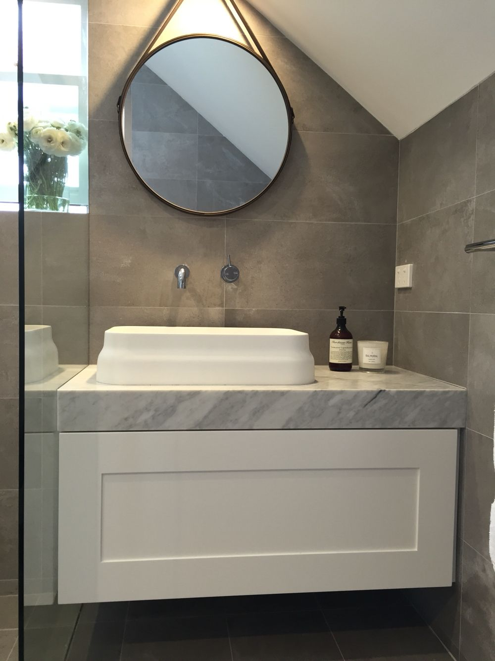 Ensuite bathroom grey and white carrara marble vanity - Round mirror over bathroom vanity ...