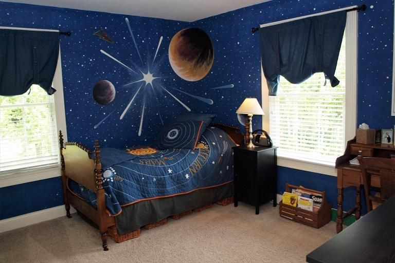 This bedroom is out of this world with stars and planets for Outer space decor ideas