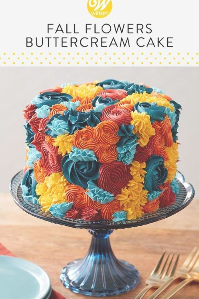 Create a fabulous (and edible!) fall flower arrangement with this Fall Flowers Buttercream Cake. Decorated with a variety of colored buttercream rosettes and stars, this fall cake features bold icing colors in fun, textured designs. A beautiful cake for a fall wedding shower or birthday party, this cake is simple enough for beginners and is a great way to show off your piping skills!