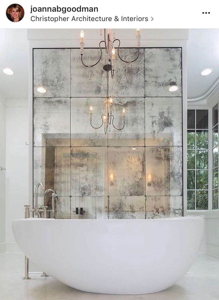 Custom Antique Mirror Featured Behind A Freestanding Bathtub In This Master Bathroom