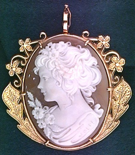 Shell Cameo Brooch with Intricate Gold Frame / http://www.iorio.com/catalogue/antique/cameo-brooch.html#